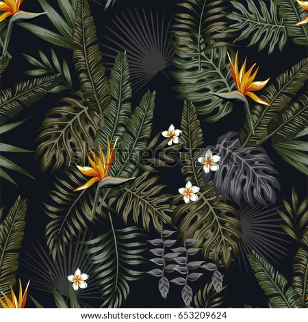 tropical leaves and flowers in