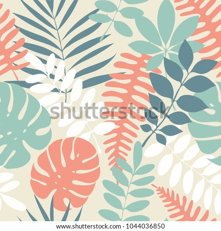 Tropical palm leaves, jungle leaves seamless vector floral pattern. Palm and monstera dense jungle. Ideal for textile. Summer background in pastel colors