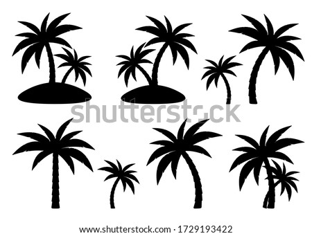 Tropical palm trees set, black silhouettes isolated on white background. Vector. ストックフォト ©