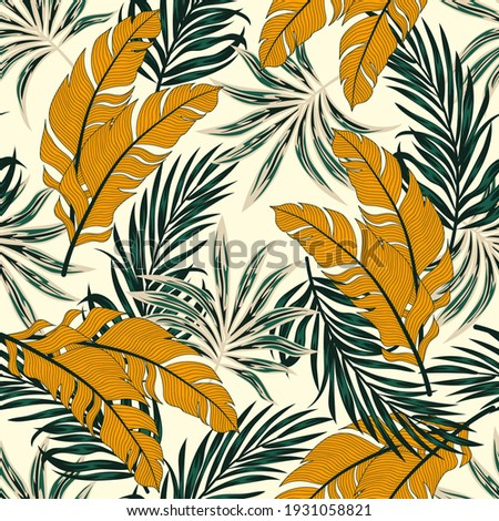 Tropical pattern with abstract plants and leaves on a yellow background. Hawaiian style. Seamless pattern with colorful leaves and plants. Colorful stylish floral.