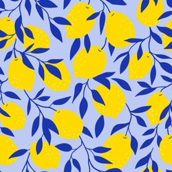 Tropical seamless pattern with yellow lemons on the blue background. Fruit repeated background. Vector bright print for fabric or wallpaper.
