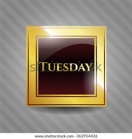 Tuesday golden emblem or badge