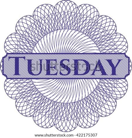 Tuesday written inside rosette