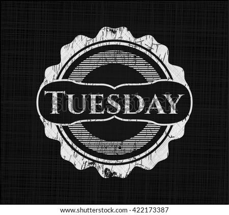 Tuesday written on a chalkboard