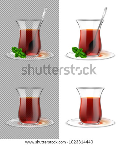 Turkish tea cup with black tea, silver spoon and mint.