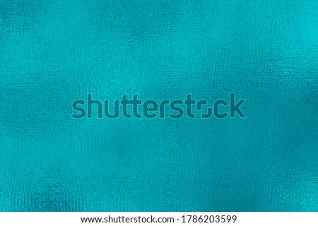 Turquoise metallic effect. Cyan texture shine foil. Background with glitterer metal effect. Blue green surface. Backdrop glitter mint metal plate. Metallic texture for design invitation, cards, prints