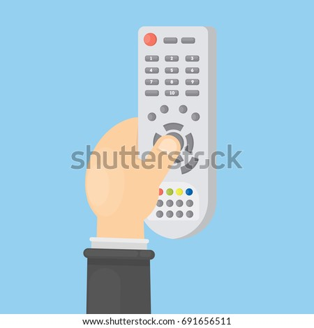 TV remote control. Hand holds remote with buttons.