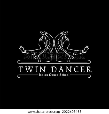 twin indian dancer logo