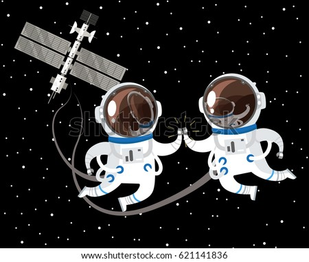 two astronauts floating around