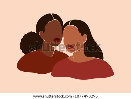 two beautiful black women stand