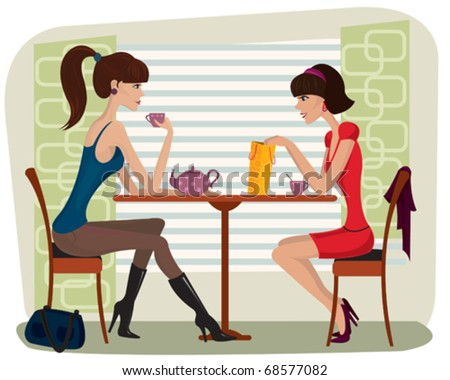 Two beautiful women in cafe