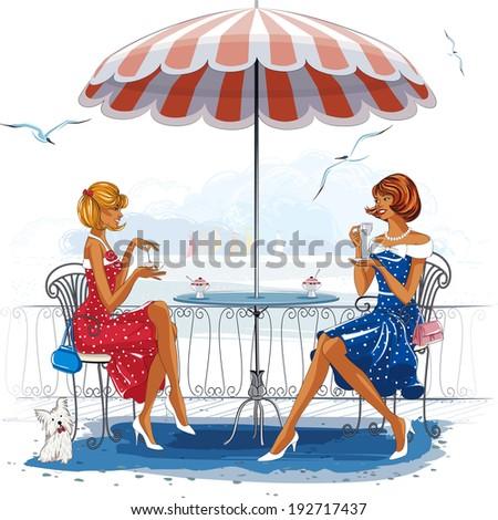 two beautiful women sitting at