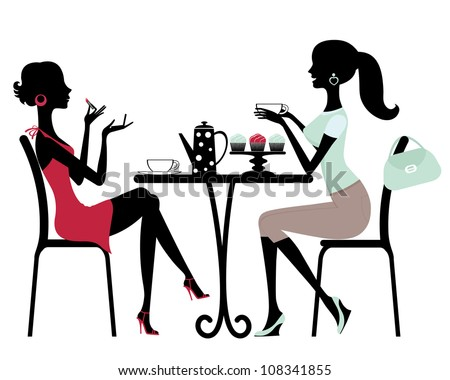 Two beautiful women sitting in a cafe