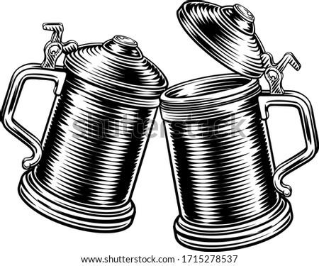 Two beer stein German Oktoberfest pint tankard mugs in a retro vintage intaglio woodcut engraved style Stockfoto ©