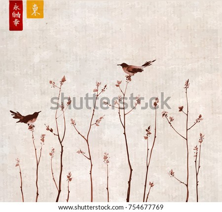 Two birds and young trees branches with fresh leaves on vintage rice paper background. Traditional oriental ink painting sumi-e, u-sin, go-hua. Hieroglyphs - eternity, freedom, happiness, east