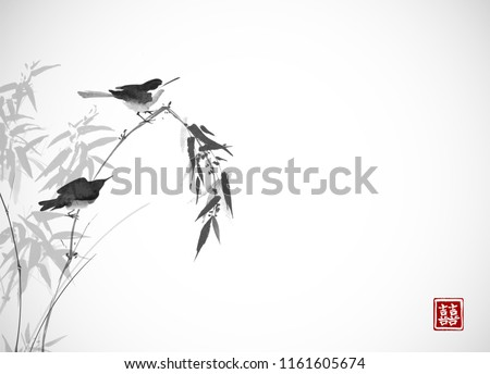two birds sitting on bamboo