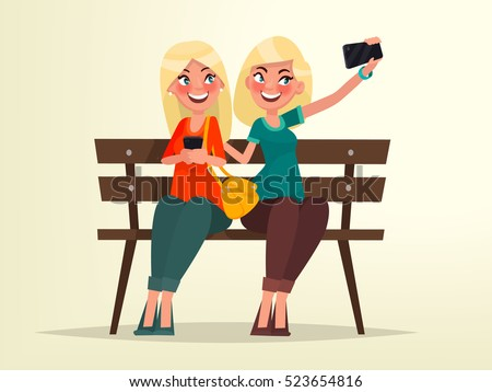 two blonde girls sitting on a