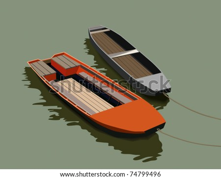 Two boats floating on the smooth surface of the water.