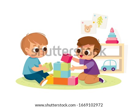 Two boys play together. Educational toys.  Educational toys. Children playing designer cubes, developmental constructor.