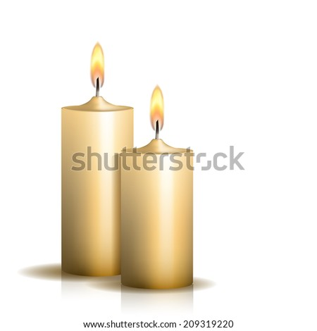 two burning candles on white