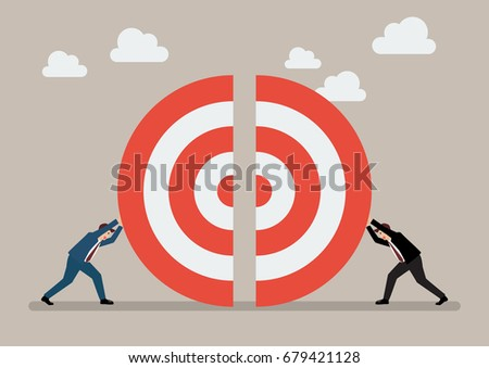 Two businessmen pushing a pieces of big target together. Business teamwork concept