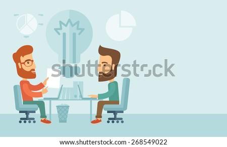 two businessmen sitting working