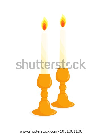 two candlesticks with burning