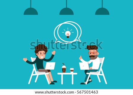 Two coworkers meeting in coffee shop.