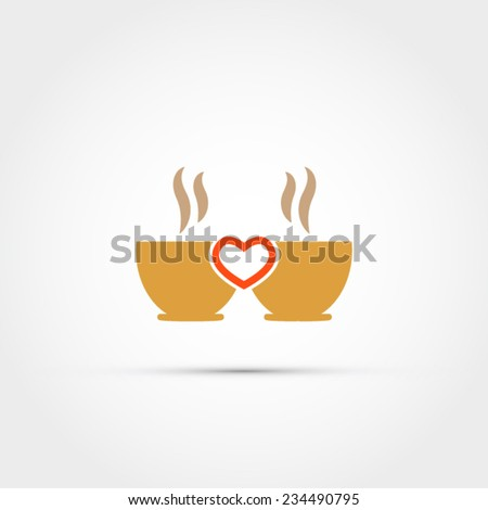 two cups of coffee with a heart