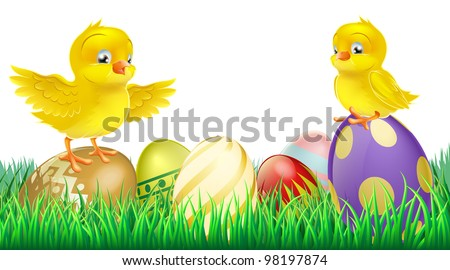 Two cute happy little yellow Easter chicks on top of colorful decorated Easter eggs