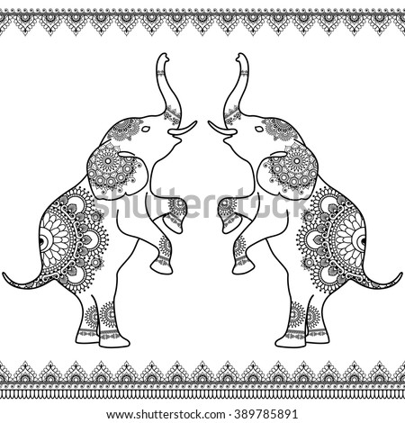 two elephants standing up with
