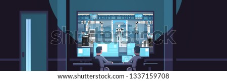 two engineers looking at monitors behind glass robot production modern factory robotic industry artificial intelligence dark office interior surveillance security system flat horizontal
