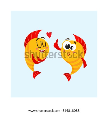 two funny  smiling golden fish
