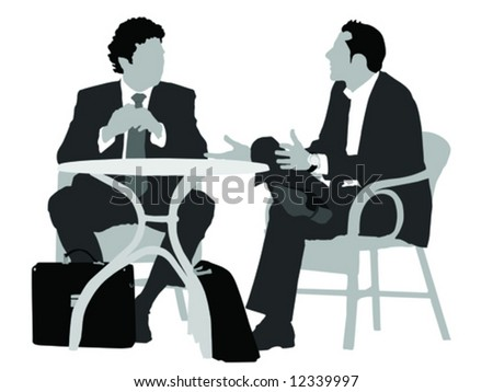 two gentlemen sitting   at
