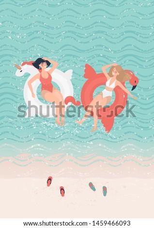 two girlfriends in bathing