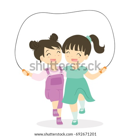 two girls playing jumping rope