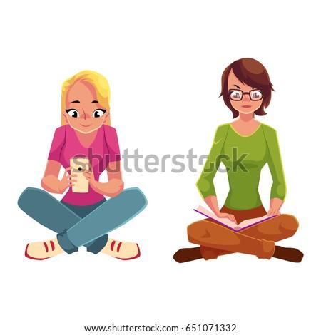 two girls siting crossed legs