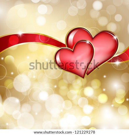 two glass red hearts on golden