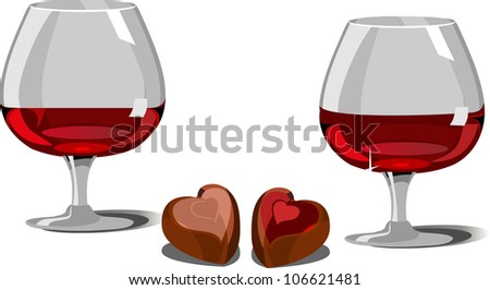 two glasses of red wine, chocolates with various fillings