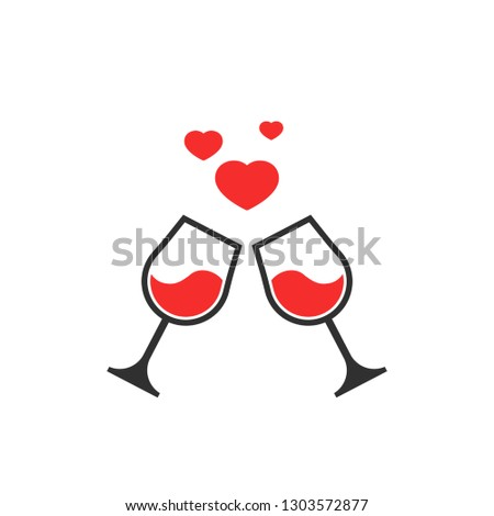 two glasses toasting with