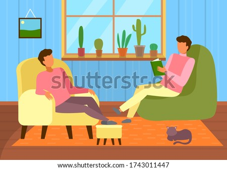 two guys sitting in armchairs