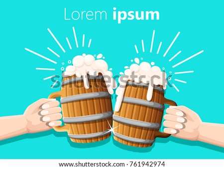 two hands holding beer in