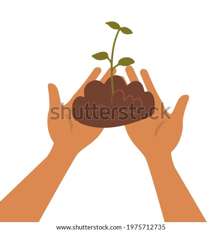 two hands holding the soil with