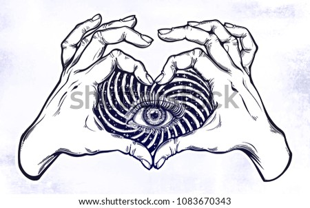 two hands making heart sign as