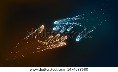two hands of glowing particles