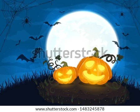 two happy pumpkins and moon on
