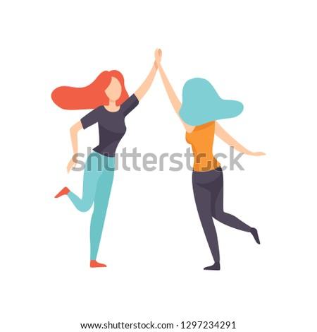 two happy women friends giving