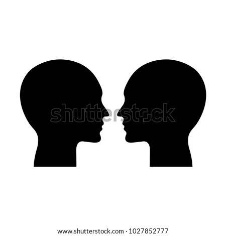 two heads facing each other....