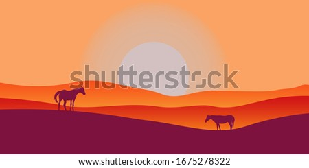 two horses graze in a valley at