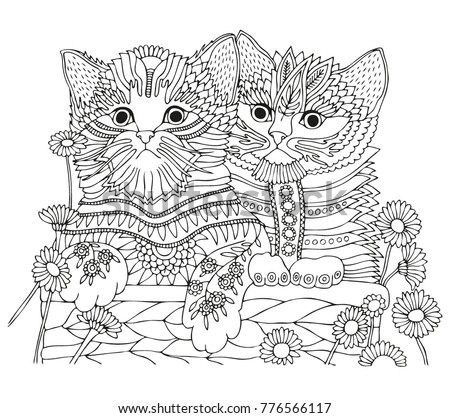 two kittens in a basket with